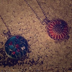 Two hand painted lockets necklaces.